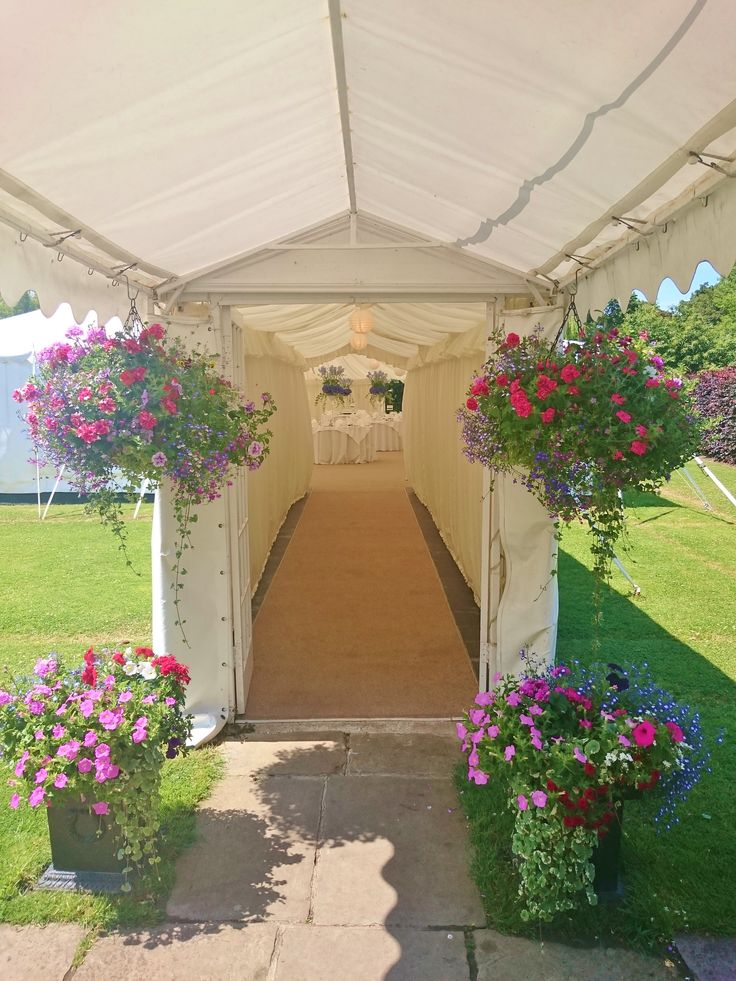 The entrance to our marquee adorned with seasonal hanging baskets http://www.prested.co.uk/high-season/