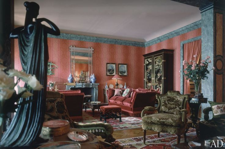 An iridescent Boussac fabric lines the resplendent Buenos Aires sitting room of Jean-Pierre Marcie-Rivière and his then-wife, Rosemarie Kanzler (AD, October 1989). The residence was renovated by architect José Maria García Calvo and decorated by Pinto. Furnishings include an ebony armoire with lacquer doors, fringed Knole sofas clad in velvet, curvaceous Victorian chairs, and a William and Mary stool.