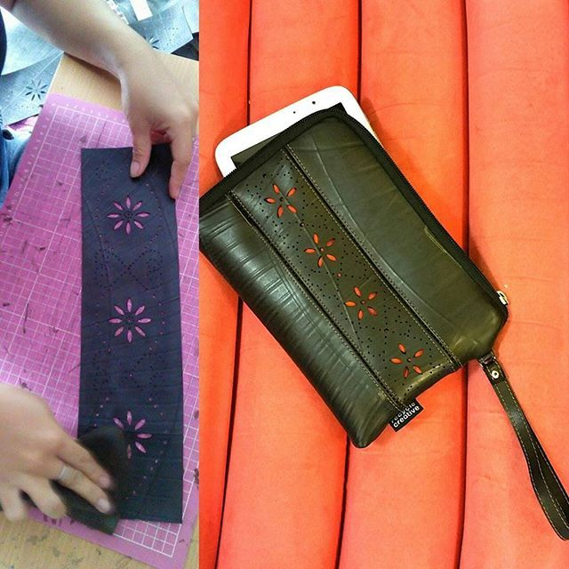 A stencil pattern is used to decorate this inner tube tablet sleeve - Recycle Creative
