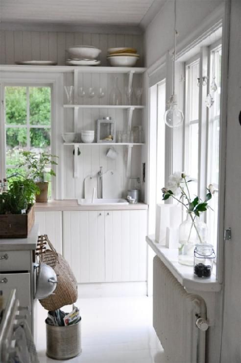 Beautiful white cottage kitchen design with white beadboard kitchen cabinets, ...open cabinet inspiration.