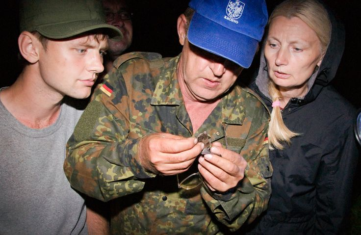 Family Demjanchuk identifies a Daubenton's bat (Myotis daubentonii) during the workshop 'Bat Research and Conservation in Belarus'. The bat was caught in a mistnet above the river Islach (Іслач) at the village Borovikovshtina (Баравікоўшчына) and after identification released at the same spot.