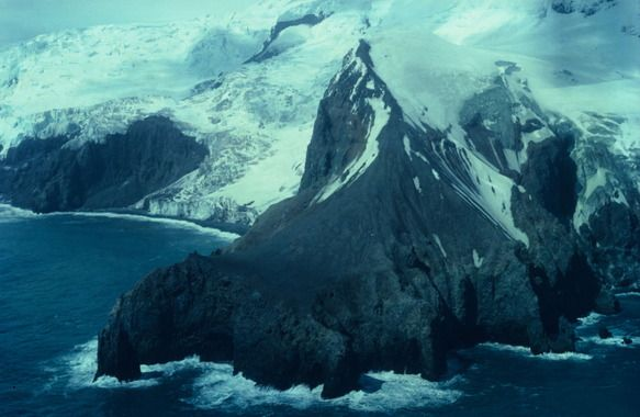 Bouvet Island (Bouvetoya). An uninhabited frozen isle halfway between South Africa and Antarctica, Bouvet Island is the most remote island in the world, and as such, perhaps the most remote landmass in the world.