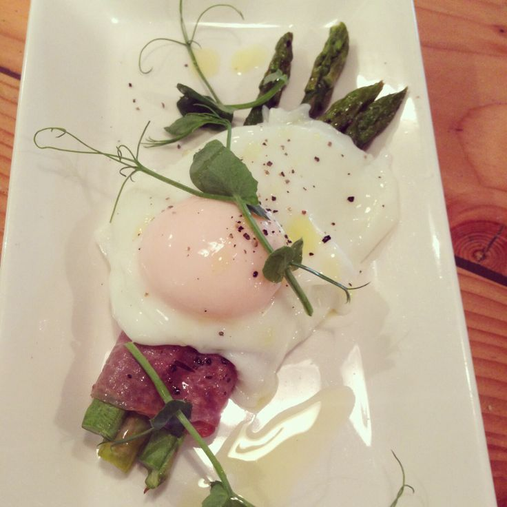 Asparagi, uovo e prosciutto Blanched asparagus wrapped with Tuscan prosciutto served with a Cornish free range poached egg and a drizzle of truffle oil. Really gets your appetite going....