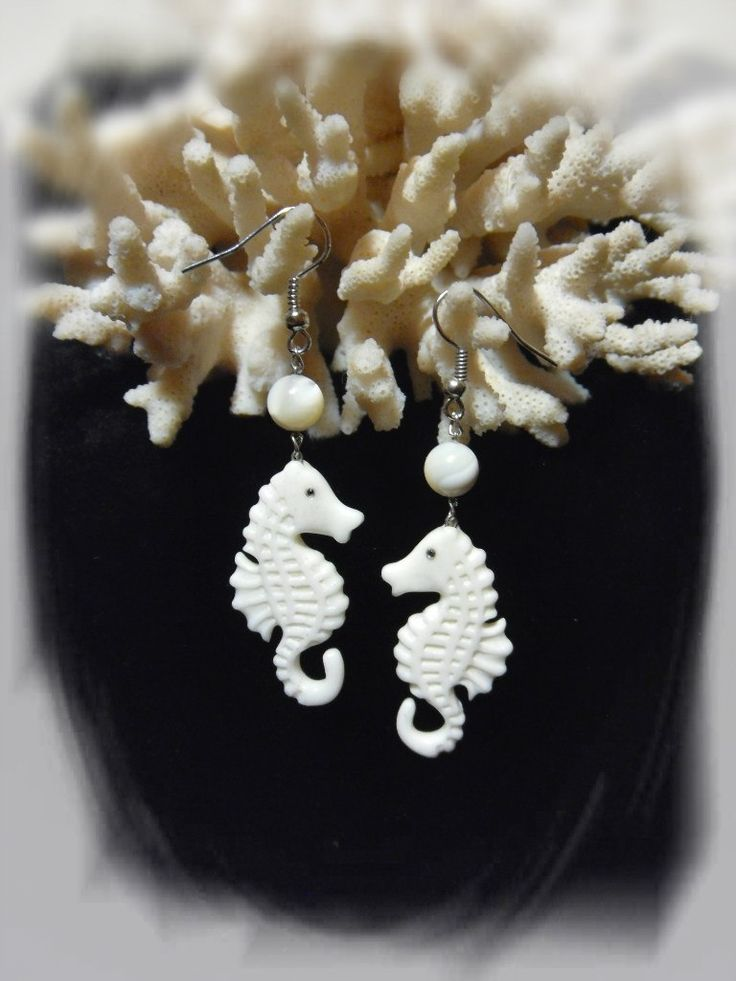 "Earrings ""sea horses"". The material is cattle bone, mother-of-pearl bead."