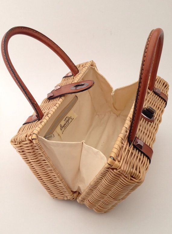 ❥ Details: Woven Wicker Rattan with Leather and Stud Detail. Double Handle with Twist Lock Metal Closure. Single Pocket with Addl Zipper Pocket. Four Metal Feet on Bottom of Purse.  ❥ Color: Metallic Gold  ❥ Material: Wicker, Leather, Nylon, Metal. ❥ Dimensions: 9 L x 4 W x 5 H  ❥ Maker: Dayne Taylor - Made in British Crown Colony of Hong Kong  ❥ Era: 1960s  ❥ Condition: Excellent Vintage Condition - Normal Wear.      ❥Please review our shop policies before purchase!    ❥Message for Combined…
