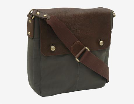 Tusk's Waterloo Collection N/S Messenger Bag. Made in ballistic nylon with soft chocolate bullhide leather trim, this unisex messenger bag is a sturdy standout. Details like polished brass hardware and an interior padded compartment for an iPad or Kindle make it a functional staple.