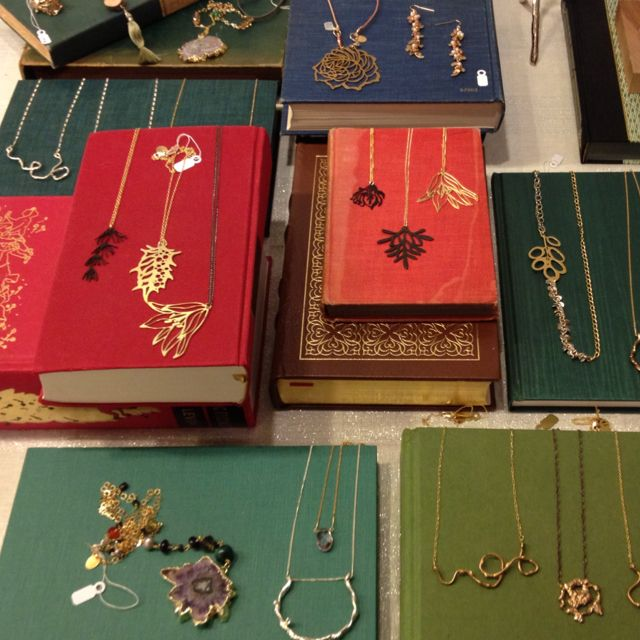 Canvase/ Pecils?? Merchandise jewelry on books #retail #display #merchandising