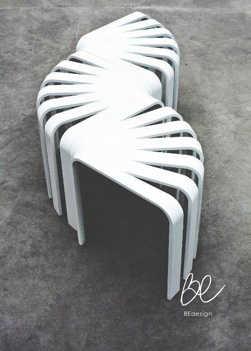 Fan stool by BEdesign. The inspiration behind the Fan stool's unique shape comes from the empty corner spaces in a room. It can be combined in several different ways thanks to its 90 degree shape, e.g. as a stool, bench or a table, and is therefore a perfect fit for any apartment.  © BEdesign