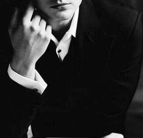 man in suit tuxedo aesthetic black and white photo no face visible character inspiration for writers