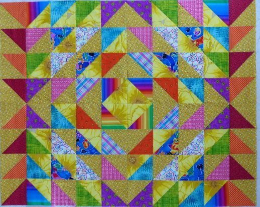 """accuquiltMargaret Kennedy made this amazing little quilt using a GO! Half-Square Triangle Die! She cuts 320 and then arranges them differently until pleased with the results. Then she sews them together to make 32""""x40"""" Baby quilts! She uses larger dies to increase the quilt size. #accuquilt #babyquilts #quilts #sewing #quiltingideas"""