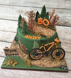 I loved making this cake to celebrate a friends 50th Birthday. The bike is handmade from modelling paste to match his orange coloured mountain bike. Everything on the cake is edible & handmade.