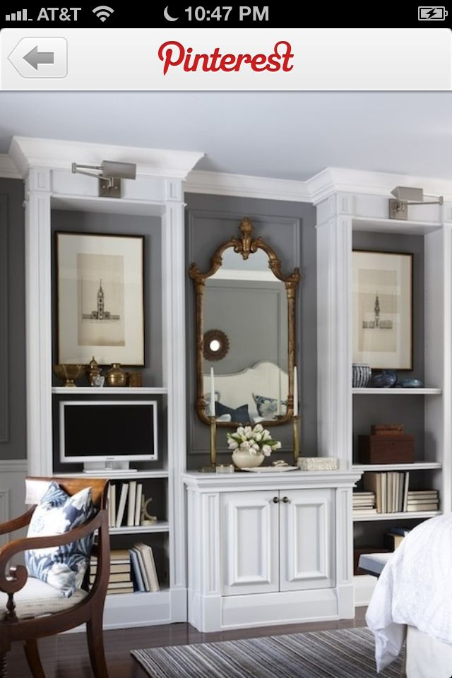 Modern shelving and lighting with antique mirror