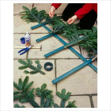 Make a flat trellis pine tree. Would be cute with small ornament in kids room!
