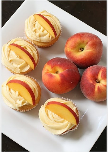 Peach Cupcakes with Cream Cheese Peach Frosting.