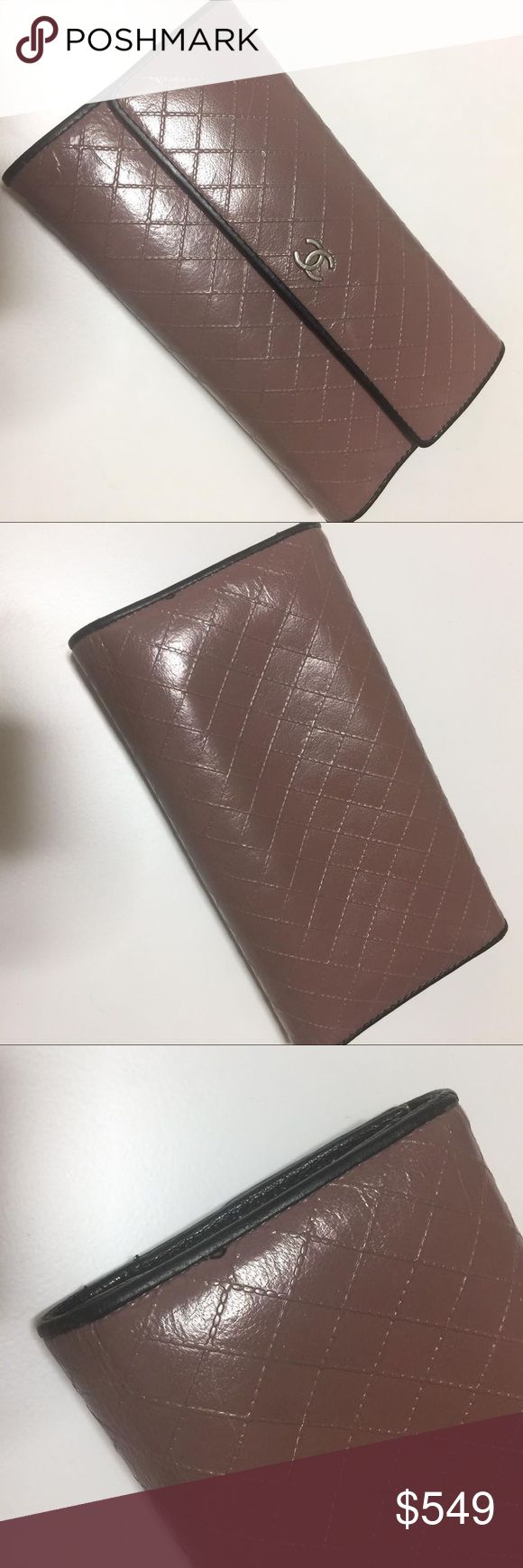 CHANEL BICOLOR TRIFOLD LONG WALLET Beautiful preowned wallet. Dusty pink with black piping. Diamond quilt. Good condition. Tiny stain on back. Authenticity card included. Price is final. Videos of most items can be seen on instagram: @theluxurylocker CHANEL Bags Wallets