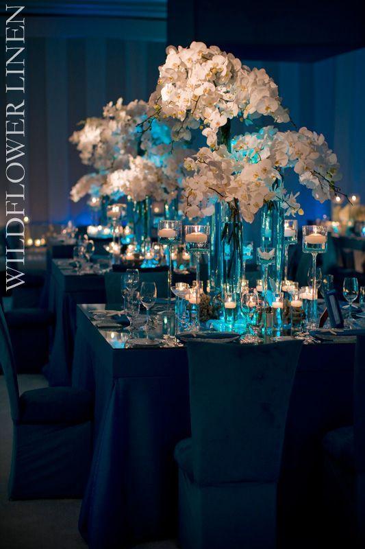 cylinder vases for centerpieces   Gorgeous blue & white centerpiece design.
