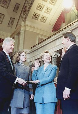 Hillary Rodham Clinton being sworn in as a United States Senator by Vice President Al Gore in the Old Senate Chamber, as President Clinton and daughter Chelsea look on. January 3, 2001.