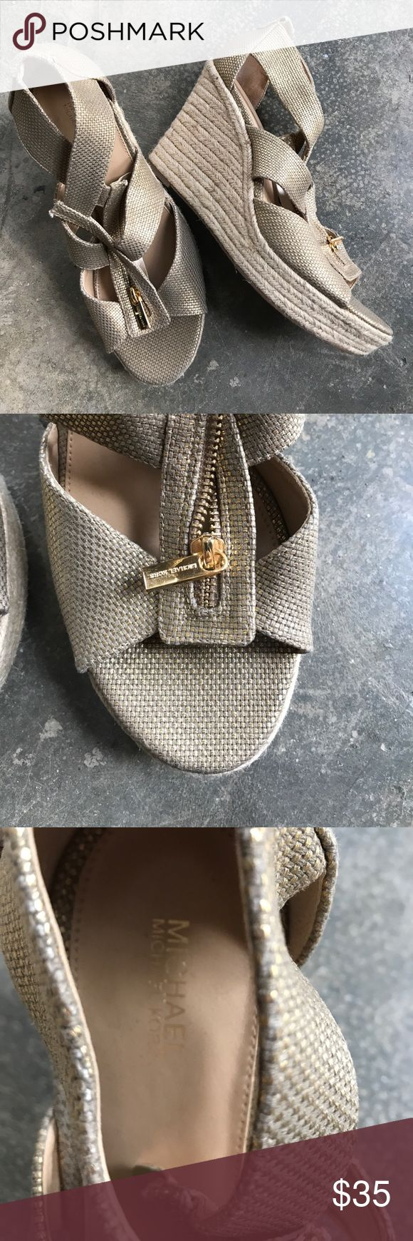 """Michael Michael Kors Metallic wedge heels 9.5 Store floor model- never worn with """"try-on"""" wear. Gold metallic zip up detail with rope wedge. Size 9.5. Heel is 4"""" with total height of 7"""" - box not included minor wear MICHAEL Michael Kors Shoes Wedges"""