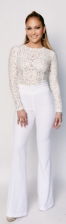 Who made Jennifer Lopez's hoop earrings, shoes, white pants, and lace long sleeve top?