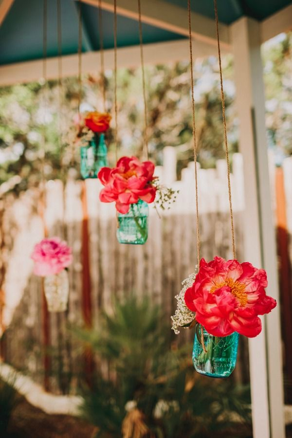 blue mason jars with hanging with peonies http://www.weddingchicks.com/2013/09/20/wedding-in-pink-and-gold/