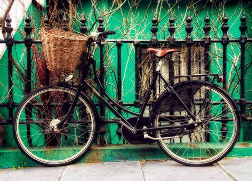 black bike on black fence