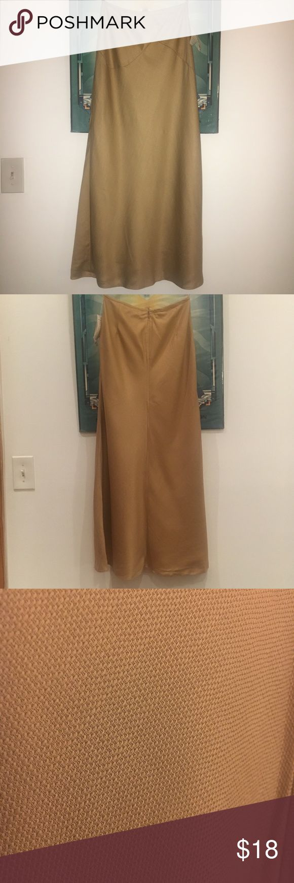 "NWT Uniqlo maxi skirt Light gold/khaki colored high waisted maxi skirt from Uniqlo. Size 0. Back zip, fully lined, textured fabric- 100% lyocell.   I exchanged something from Uniqlo for this and realized it didnt fit after the return date! 😫  Skirt measures 36"" in length, waist 13"" lying flat. Uniqlo Skirts Maxi"