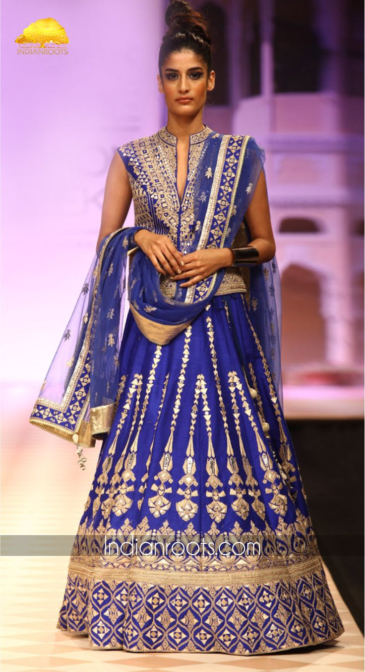 Royal blue raw silk lehenga with traditional gota patti embroidery, inspired by the Jantar Mantar architecture. The lehenga comes with a raw silk choli and a net dupatta by Anita Dongre on Indianroots.com