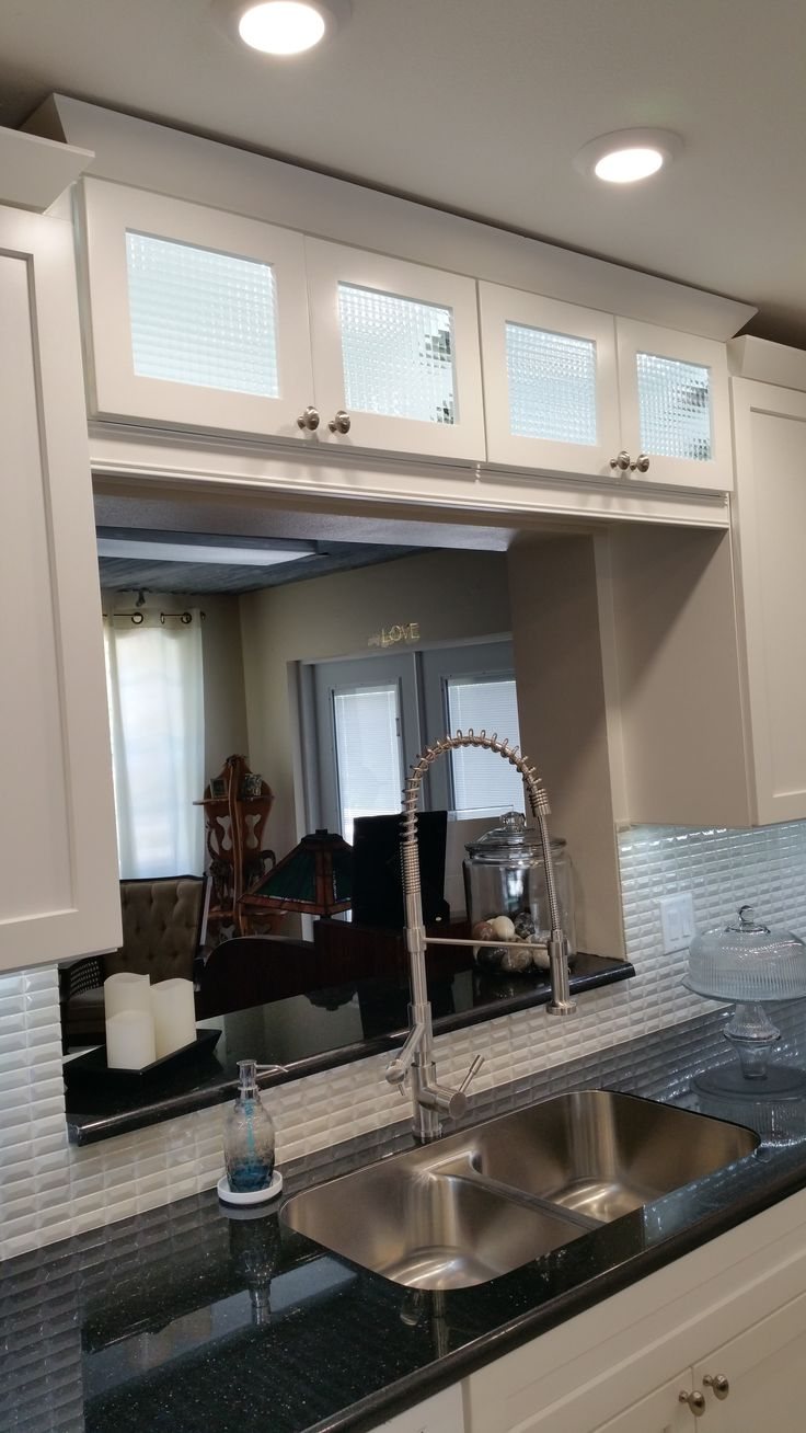 Cross reeded glass cabinets over the sink