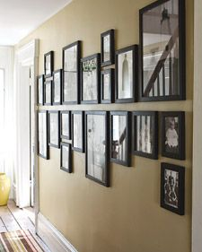 Hanging multiple framed pictures so that they look orderly can be a challenge. The secret is to divide and conquer: Mark a horizontal midline on the wall, and hang all pictures above or below it.    Read more at Marthastewart.com: Curtain, Frame, and Shelving Ideas – Martha Stewart