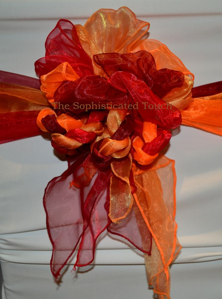 Multi Coloured Organza Bows on White Chair Covers.   The Sophisticated Touch ...Chair Covers by Design