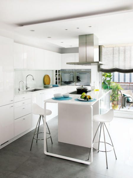 white kitchen, shiny white back splash, grey stone floor, cool shiny white island