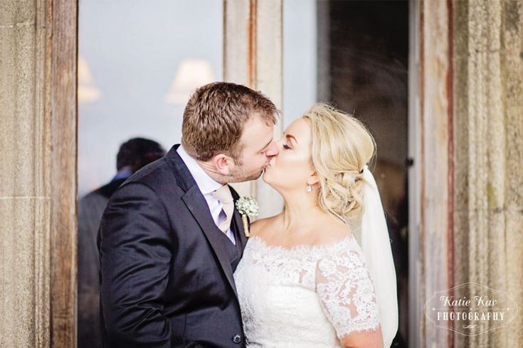 Did you know rain on your wedding day is good luck? Julie was wearing a gorgeous Pronovias wedding dress.