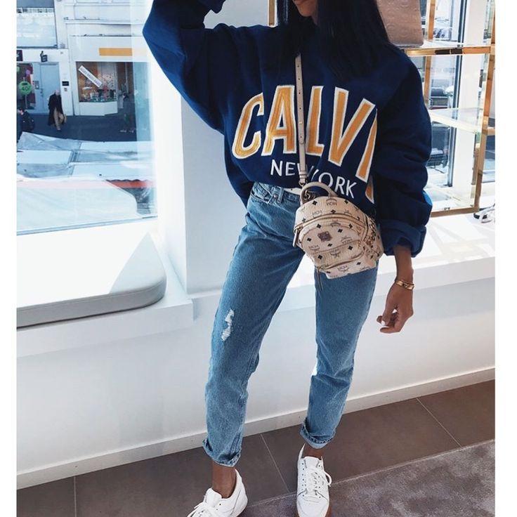 Woman style: sweatshirt jeans basketball.