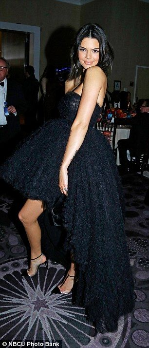 Outfit change: The party-hopping star ensured she was the centre of attention in her slinky eveningwear