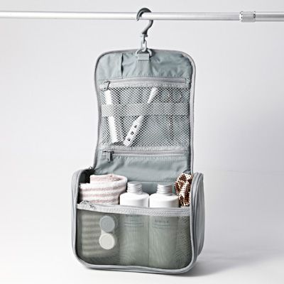 Muji travel toiletries case: small clear muji bag: tampons, liners, birth control; q-tips, hair ties, bobby pins, toothpaste, razor