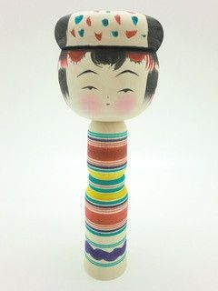 Traditional wooden doll from Miyagi: Yajiro kokeshi doll.