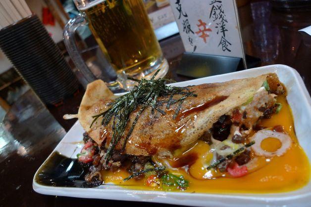An okonomiyaki dish called issen yoshoku is the only dish on the menu at Issen Yoshoku restaurant. Photo: Spud Hilton, The Chronicle