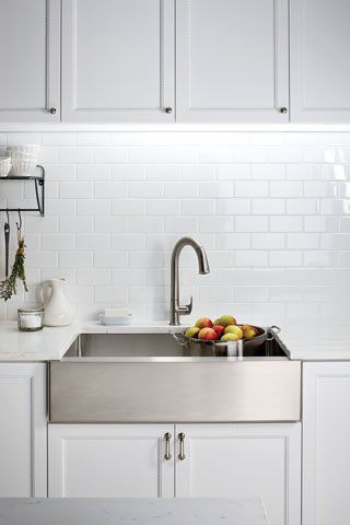 A style-savvy update of the traditional farmhouse sink, Kohler's apron-front Strive version in stainless steel would suit the modern kitchen or, in a traditional space, impart a smart, contemporary feel. Besides stunning visual interest, the 16-gauge steel basin offers durability and its tight corners make it easy to clean. From $1,440. #kitchens #architecture #design