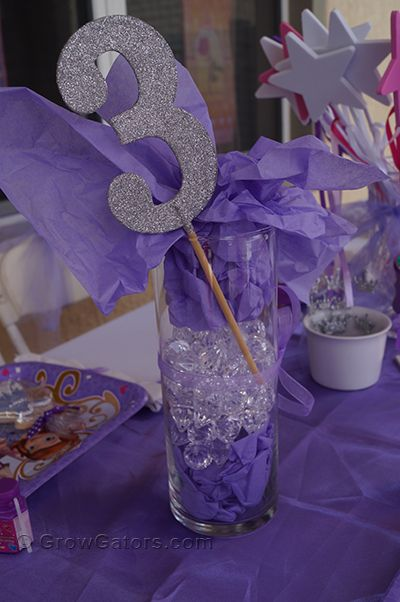 Glass container, jewels, tissue paper, ribbon, and #3 from Hobby Lobby. Sofia the First birthday centerpiece. Read more at http://www.growgators.com/2016/09/sofia-the-first-a-3rd-birthday-party-for-our-princess/
