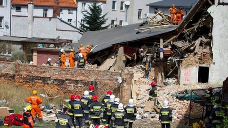 An apartment house collapsed Saturday in southwestern Poland leaving four people dead four injured and two others missing authorities said.  Scores of firefighters with dogs were searching the rubble of the building in the town of Swiebodzice (Shvyeh-'boh-tchi-tseh) according to Daniel Mucha regional spokesman for the firefighters.  He said the collapse of two floors of the three-floor building might have been caused by a gas explosion.  Regional governor Pawel Hreniak said the…