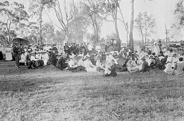 A large group of children and their families at a picnic in a bush setting, for the Hopefield State School, c1895.