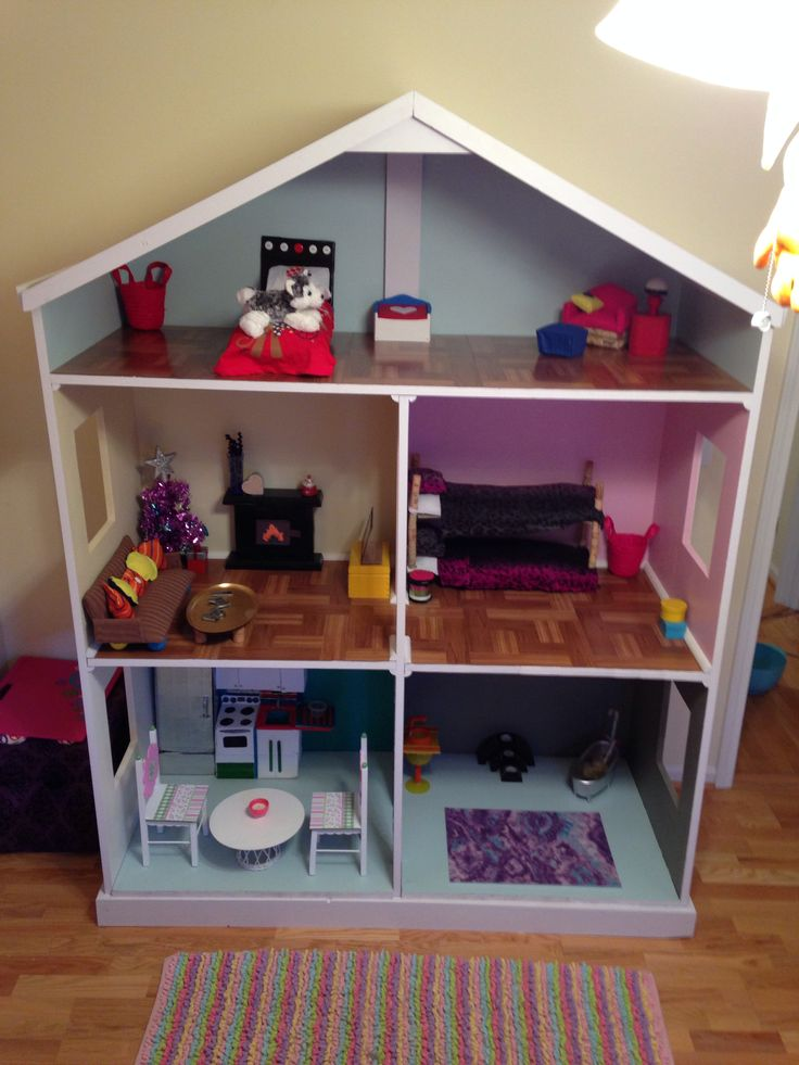 American Girl Dollhouse. 7' tall, 5' wide, 2' deep. Almost all furniture homemade!