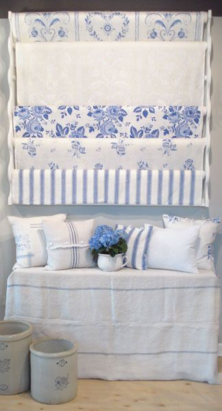 """I love everything about this picture. Linens, pillows, crocks.    Exclusive linen fabric by Swedish Designer Ingela Westergaard. Handprinted in Dalarna, Sweden.    In picture, from top to bottom:""""Tulips and Hearts""""Blue/White; """"Tulips and Hearts"""" White/White; """"Roskulla"""" Blue/Lavender; """"Porslinsros"""" Blue/White; """"Lagerrand"""" Blue/white."""