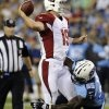 Arizona Cardinals quarterback John Skelton (19) is sacked for a six-yard loss by Tennessee Titans defensive end Kamerion Wimbley (95)