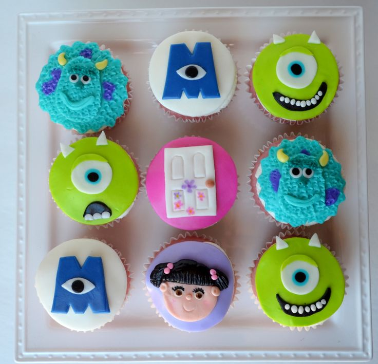 - Monsters Inc strawberry cupcakes with vanilla bc and fondant toppers. I had so much fun making these!