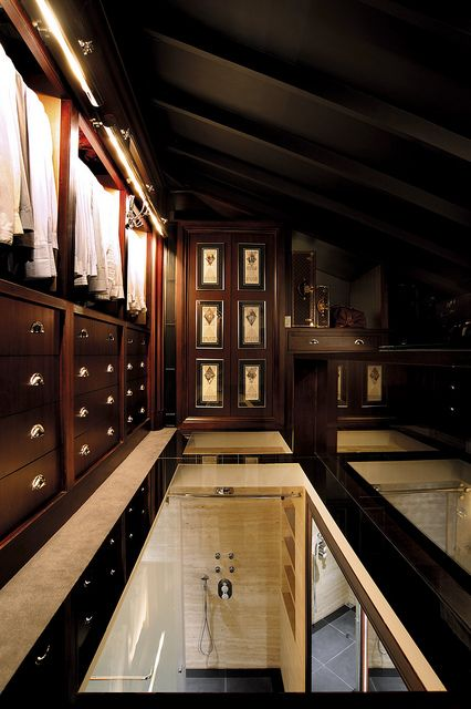 Masculine dark wood glass floors walk in closet