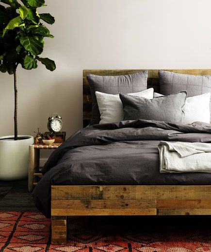 Pairing solid pillows and sheets in a single color scheme is about as goofproof as a bedding set, but it looks a lot more interesting.