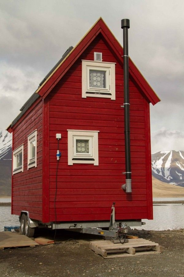 Check out this Tiny Red Cottage on Wheels in Longyearbyen