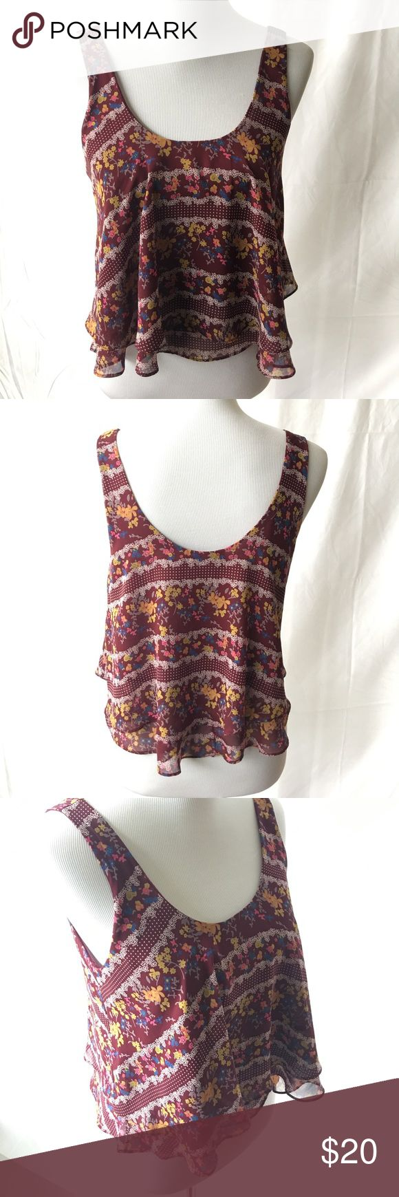 🎉SALE🎉Floral Double Ruffle Cami Tank Gorgeous floral double Ruffle Cami crop tank in Burgundy. Brand is Soprano from Nordstrom. Like NEW condition. 100% Polyester. Reasonable offers welcome. 20% off bundles. Nordstrom Tops Tank Tops