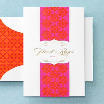 BRIDES Fine Wedding Papers. Embrace joyful color with rich texture! Henna-inspired block prints combine hot pink and persimmon orange. Swarovski crystals add the crowning touch! White wallet flap envelopes come standard with these invitations.��View more at BRIDESFineWeddingPapers.com